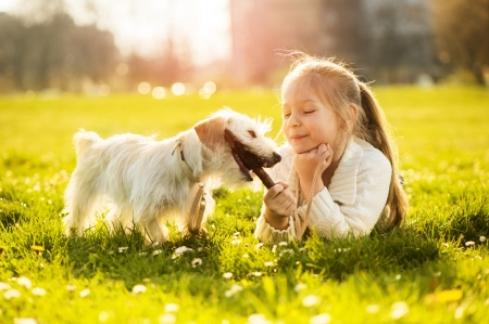 Little girl with her puppy dog